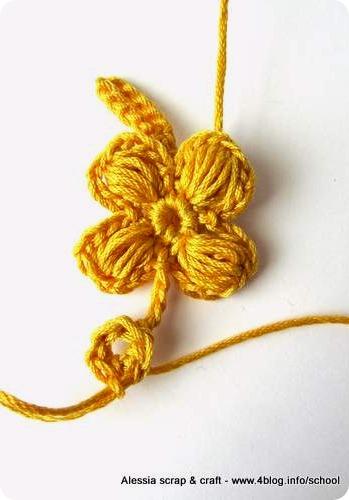 Prove di puff stitch flower in giallo