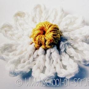 Scuola di uncinetto: come fare una margherita con catenella e maglia bassa