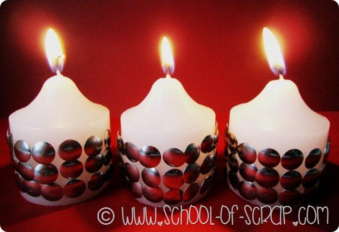 Decorazioni di Capodanno fai da te: candele con borchie argentate
