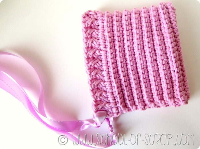 Uncinetto con un gomitolo: la cuffietta bonnet per neonati